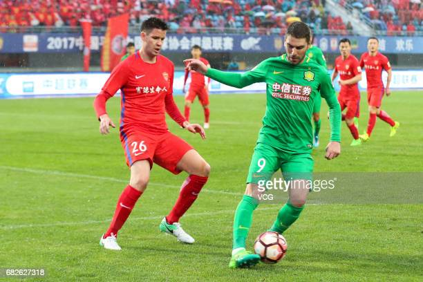 Jonathan Soriano of Beijing Guoan and Richard Guzmics of Yanbian Fude FC compete for the ball during the 9th round match of 2017 Chinese Football...
