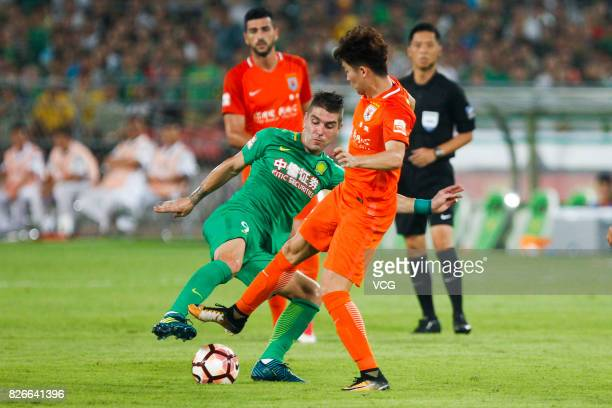 Jonathan Soriano of Beijing Guoan kicks the ball during the 20th round match of 2017 Chinese Football Association Super League between Beijing Guoan...