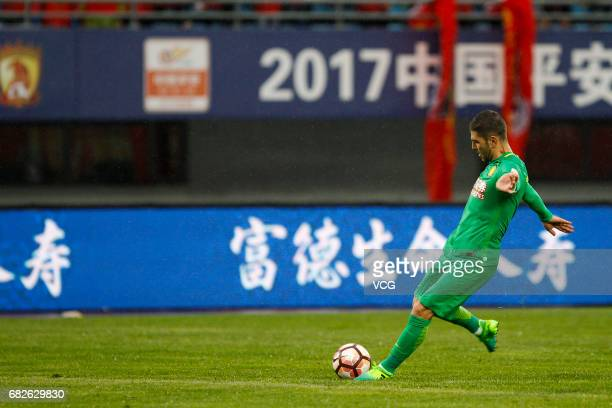 Jonathan Soriano of Beijing Guoan kicks the ball during the 9th round match of 2017 Chinese Football Association Super League between Yanbian Fude...