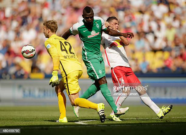 Jonathan Soriano of Salzburg and Assani Lukyma and Felix Wiedwald goalkeeper of Bremen fight for the ball during the preseason semi final 1 match...