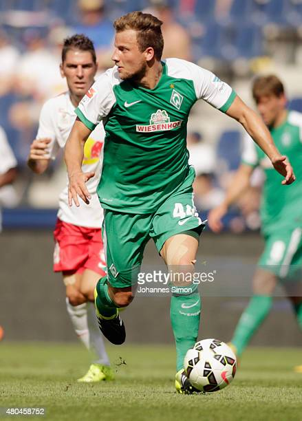 Jonathan Soriano of Salzburg and Philipp Bargede of Bremen fight for the ball during the preseason semi final 1 match between FC Red Bull Salzburg...