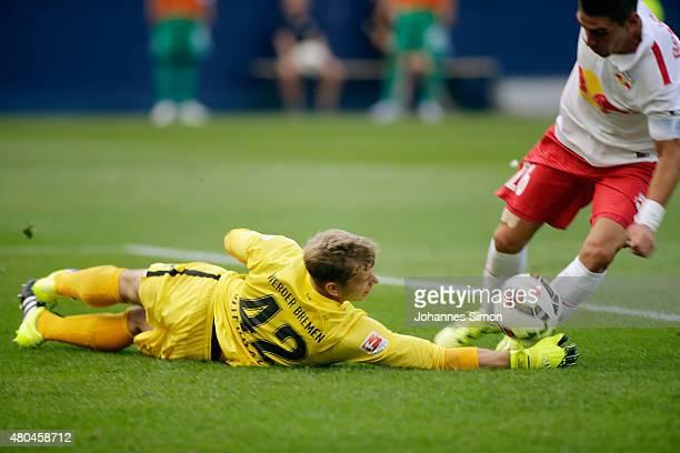 Jonathan Soriano of Salzburg tries to score against Felix Wiedwald goalkeeper of Bremen during the preseason semi final 1 match between FC Red Bull...