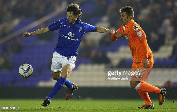 Jonathan Spector of Birmingham and Angel Martinez of Blackpool chalenge for the ball during the npower Championship match between Birmingham City and...