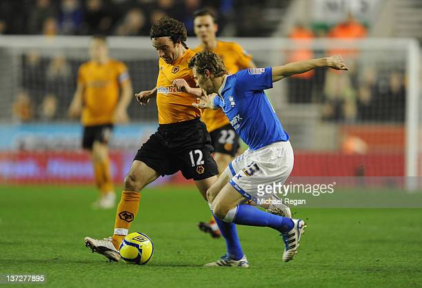 Jonathan Spector of Birmingham challenges Stephen Hunt of Wolves during the FA Cup Third Round replay between Wolverhampton Wanderers and Birmingham...