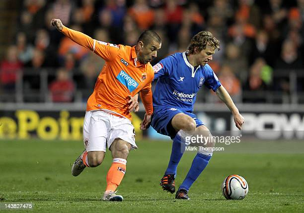 Jonathan Spector of Birmingham City competes with Kevin Phillips of Blackpool during the npower Championship Playoff Semi Final 1st leg match between...