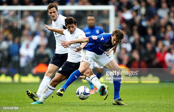 Jonathan Spector of Birmingham holds off the challenge of Anthony Knockaert of Leicester during the npower Championship match between Birmingham City...