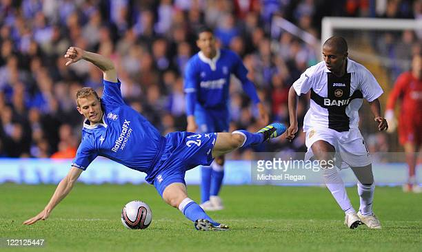 Jonathan Spector of Birmingham is challenged by Diego Barcelos of CD Nacional during the UEFA Europa League PlayOff match between Birmingham City FC...