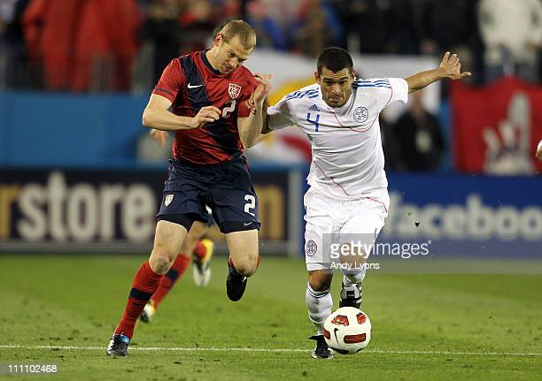 Jonathan Spector of the United States and Miguel Samudio of Paraguay battle for the ball during an international friendly match at LP Field on March...