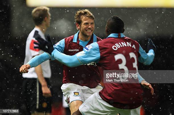 Jonathan Spector of West Ham United celebrates his goal with Victor Obinna during the Carling Cup Quarter Final match between West Ham United and...