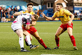 Jonathan Spratt of Ospreys is tackled by Jake Conway of Scarlets during the Singha Premiership Rugby 7's Group A match between the Ospreys 7's v...