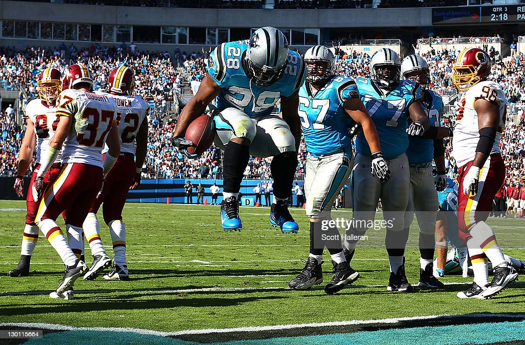 <a gi-track='captionPersonalityLinkClicked' href=/galleries/search?phrase=Jonathan+Stewart&family=editorial&specificpeople=2205176 ng-click='$event.stopPropagation()'>Jonathan Stewart</a> #28 of the Carolina Panthers celebrates a second half touchdown against the Washington Redskins during their game at Bank of America Stadium on October 23, 2011 in Charlotte, North Carolina.