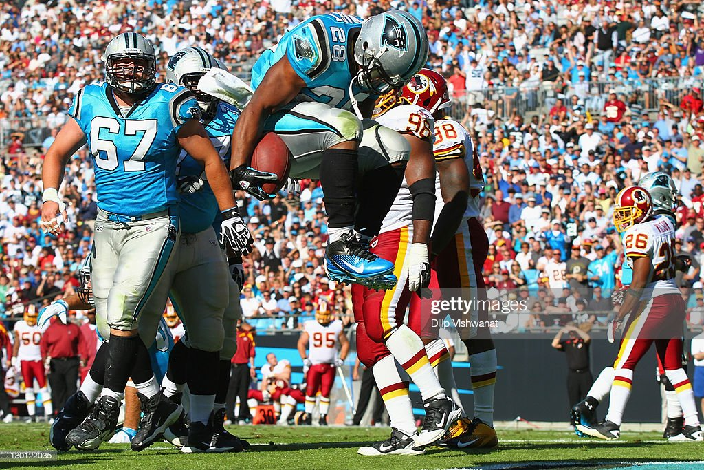 <a gi-track='captionPersonalityLinkClicked' href=/galleries/search?phrase=Jonathan+Stewart&family=editorial&specificpeople=2205176 ng-click='$event.stopPropagation()'>Jonathan Stewart</a> #28 of the Carolina Panthers celebrates his touchdown against the Washington Redskins at the Bank of America Stadium on October 23, 2011 in Charlotte, North Carolina.