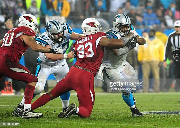 Jonathan Stewart of the Carolina Panthers is tackled by Calais Campbell of the Arizona Cardinals during the NFC Wild Card Playoff game on January 3...