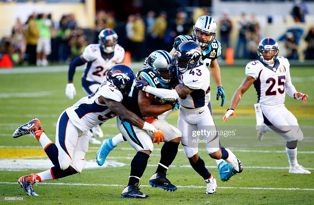 <a gi-track='captionPersonalityLinkClicked' href=/galleries/search?phrase=Jonathan+Stewart&family=editorial&specificpeople=2205176 ng-click='$event.stopPropagation()'>Jonathan Stewart</a> #28 of the Carolina Panthers is tackled by <a gi-track='captionPersonalityLinkClicked' href=/galleries/search?phrase=T.J.+Ward&family=editorial&specificpeople=4640262 ng-click='$event.stopPropagation()'>T.J. Ward</a> #43 of the Denver Broncos in the first quarter during Super Bowl 50 at Levi's Stadium on February 7, 2016 in Santa Clara, California.