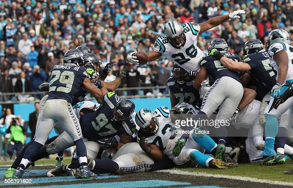 Jonathan Stewart of the Carolina Panthers reaches across the goal line to score a touchdown during the second quarter of the NFC Divisional Playoff...