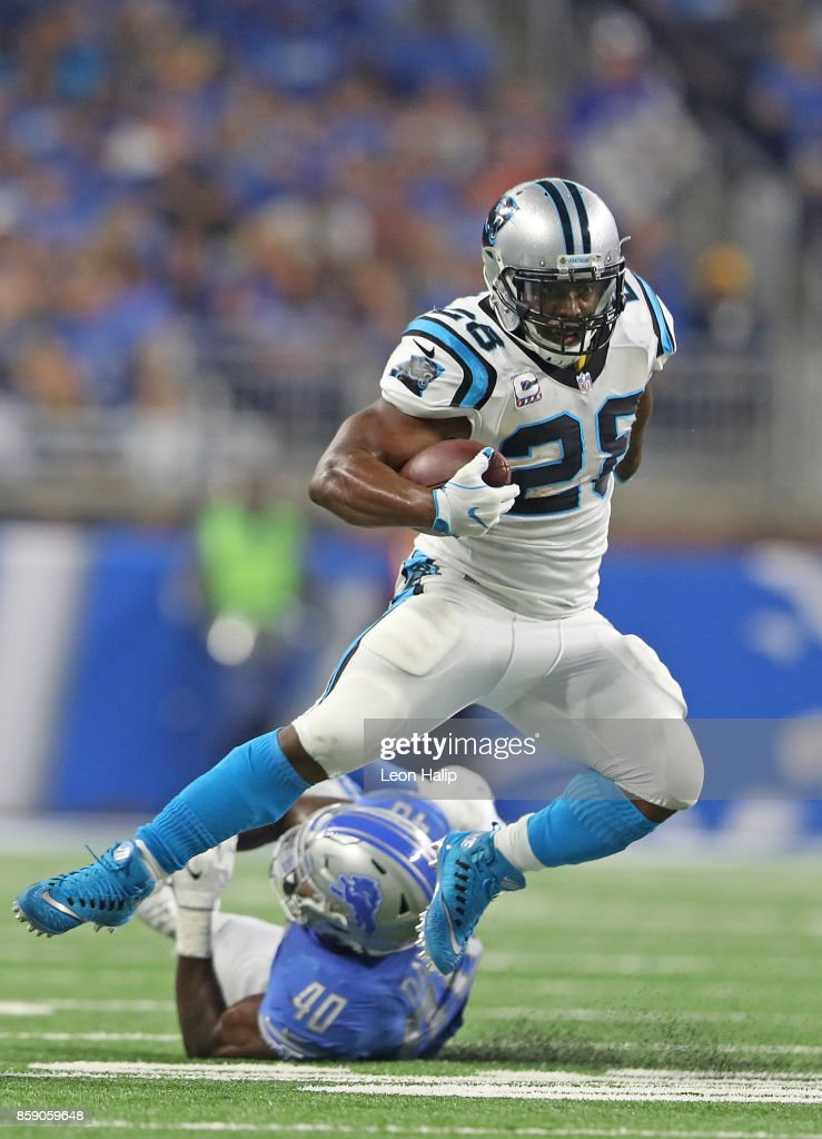 Jonathan Stewart #28 of the Carolina Panthers runs for a first down as Jarrad Davis #40 of the Detroit Lions attempts to make the stop during the second quarter of the game against the Detroit Lions at Ford Field on October 8, 2017 in Detroit, Michigan.