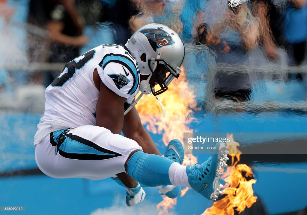 Jonathan Stewart #28 of the Carolina Panthers runs onto the field before their game against the New Orleans Saints at Bank of America Stadium on September 24, 2017 in Charlotte, North Carolina.