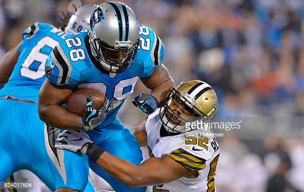 Jonathan Stewart of the Carolina Panthers runs the ball against Craig Robertson of the New Orleans Saints in the 1st quarter during the game at Bank...