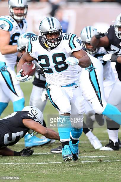 Jonathan Stewart of the Carolina Panthers runs with the ball during the game against the Oakland Raiders at the OaklandAlameda County Coliseum on...