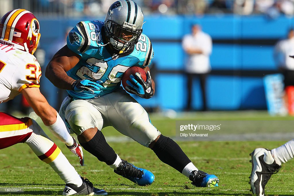 <a gi-track='captionPersonalityLinkClicked' href=/galleries/search?phrase=Jonathan+Stewart&family=editorial&specificpeople=2205176 ng-click='$event.stopPropagation()'>Jonathan Stewart</a> #28 of the Carolina Panthers rushes against the Washington Redskins at the Bank of America Stadium on October 23, 2011 in Charlotte, North Carolina.