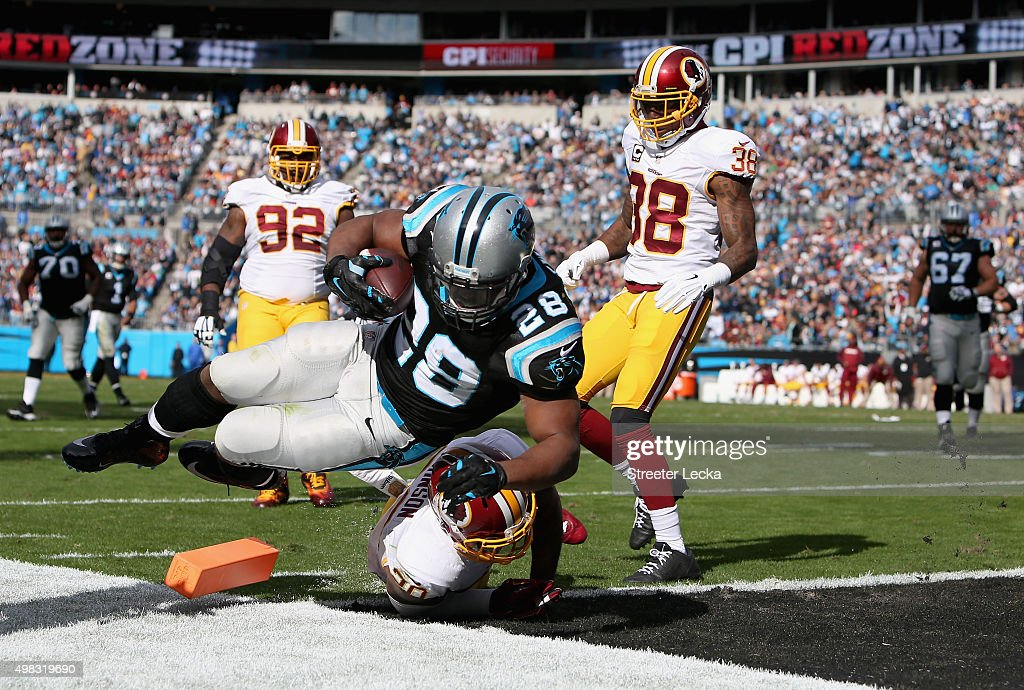 Jonathan Stewart #28 of the Carolina Panthers scores a touchdown against Jeron Johnson #20 of the Washington Redskins in the 1st quarter during their game at Bank of America Stadium on November 22, 2015 in Charlotte, North Carolina.