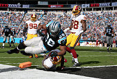 Jonathan Stewart of the Carolina Panthers scores a touchdown against Jeron Johnson of the Washington Redskins in the 1st quarter during their game at...