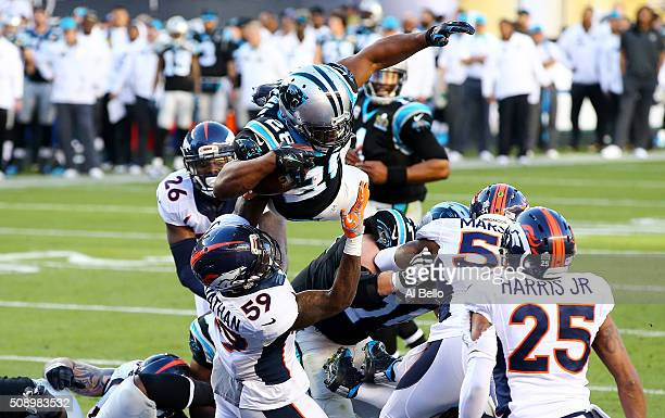 Jonathan Stewart of the Carolina Panthers scores a touchdown against the Denver Broncos in the second quarter during Super Bowl 50 at Levi's Stadium...
