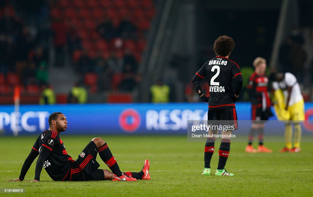 Jonathan Tah (L) and Andre Ramalho of Bayer Leverkusen (2) look dejected as they lose 2-0 on aggregate after the UEFA Europa League round of 16, second leg match between Bayer Leverkusen and Villarreal CF at Bay Arena on March 17, 2016 in Leverkusen, Germany.