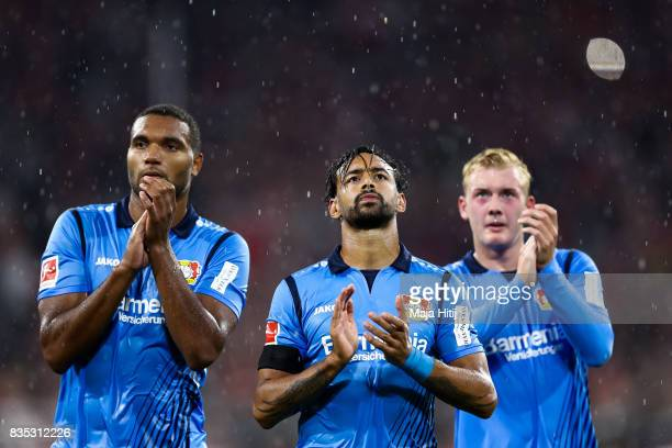 Jonathan Tah Karim Bellarabi and Julian Brandt of Leverkusen react after the Bundesliga match between FC Bayern Muenchen and Bayer 04 Leverkusen at...
