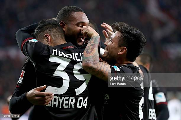 Jonathan Tah of Bayer Leverkusen celebrates with Charles Aranguiz of Bayer Leverkusen after scoring his teams first goal during the Bundesliga match...