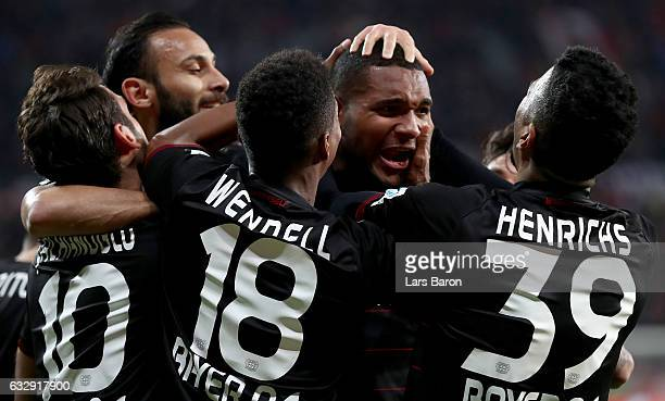 Jonathan Tah of Bayer Leverkusen celebrates with team mates after scoring his teams first goal during the Bundesliga match between Bayer 04...