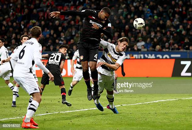 Jonathan Tah of Bayer Leverkusen heads his teams first goal during the Bundesliga match between Bayer 04 Leverkusen and Borussia Moenchengladbach at...