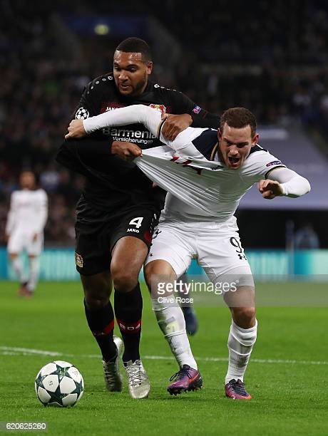 Jonathan Tah of Bayer Leverkusen pulls the shirt of Vincent Janssen of Tottenham Hotspur during the UEFA Champions League Group E match between...