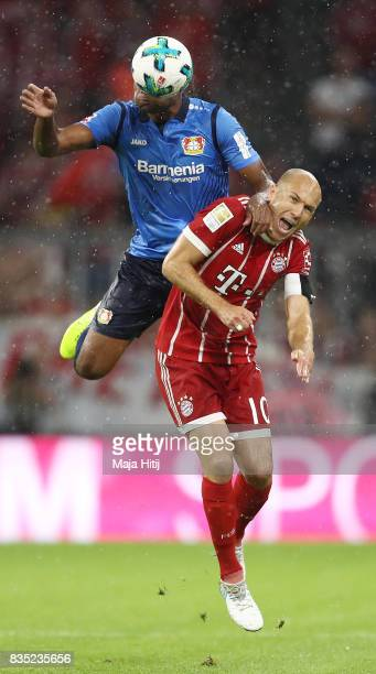 Jonathan Tah of Bayer Leverkusen with Arjen Robben of Bayern Muenchen during the Bundesliga match between FC Bayern Muenchen and Bayer 04 Leverkusen...