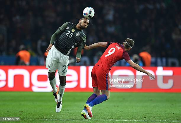 Jonathan Tah of Germany and Harry Kane of England compete for the ball during the International Friendly match between Germany and England at...