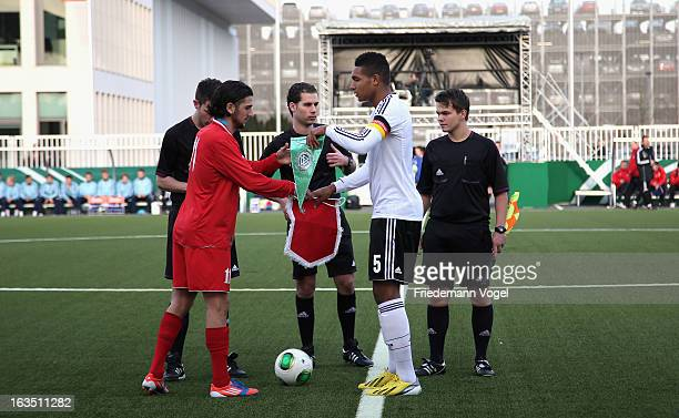 Jonathan Tah of Germany and Ilia Kerdzevadze of Georgia change the pennant during the U17 International Friendly match between Germany and Georgia at...