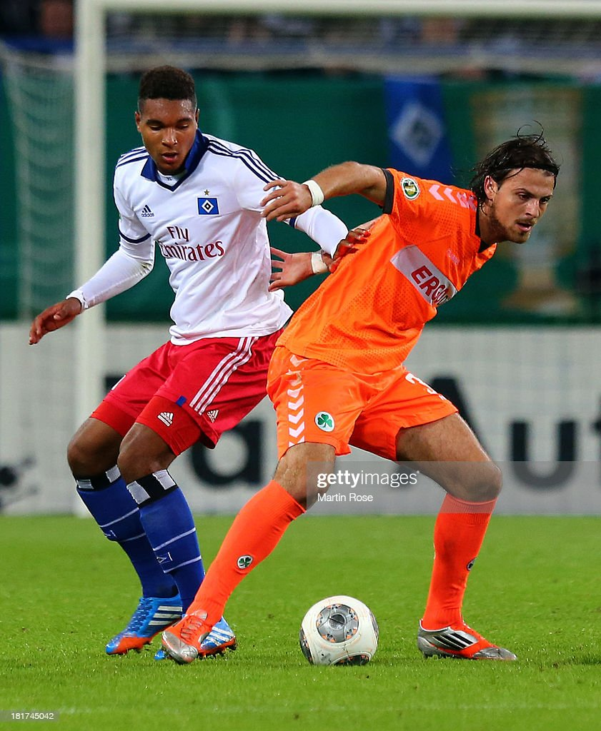 Jonathan Tah (L) of Hamburg and Ilir Azemi (R) of Greuther Fuerth battle for the ball during the DFB Cup second round match between Hamburger SV and Greuther Fuerth at Imtech Arena on September 24, 2013 in Hamburg, Germany.