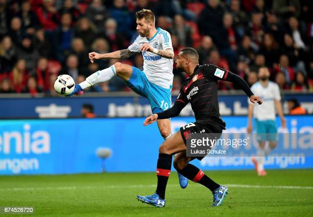 Jonathan Tah of Leverkusen and Guido Burgstaller of Schalke battle for the ball during the Bundesliga match between Bayer 04 Leverkusen and FC...
