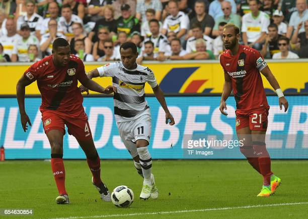 Jonathan Tah of Leverkusen and Raffael of Moenchengladbach and Ömer Toprak of Leverkusen battle for the ball during the Bundesliga match between...