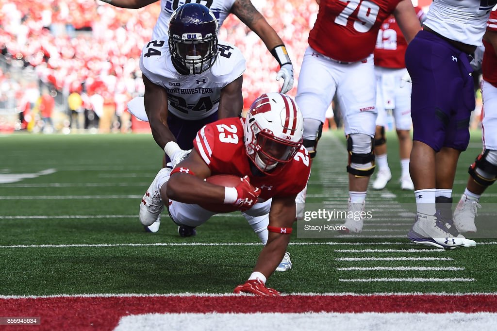 Jonathan Taylor #23 of the Wisconsin Badgers dives for a touchdown during the first quarter of a game against the Northwestern Wildcats at Camp Randall Stadium on September 30, 2017 in Madison, Wisconsin.