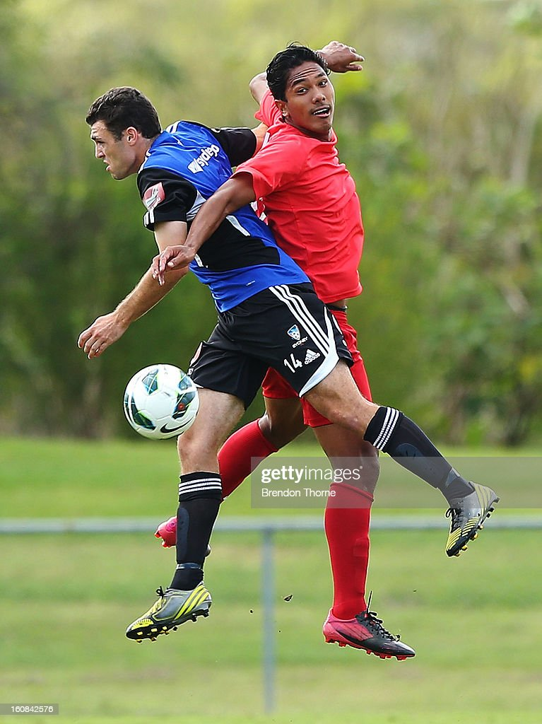 Jonathan Tehau of Tahiti competes with of Mitchell Mallia of Sydney during the friendly match between Sydney FC and Tahiti at Macquarie Uni on February 6, 2013 in Sydney, Australia.