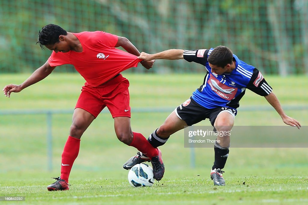 Jonathan Tehau of Tahiti competes with of Peter Triantis of Sydney during the friendly match between Sydney FC and Tahiti at Macquarie Uni on February 6, 2013 in Sydney, Australia.