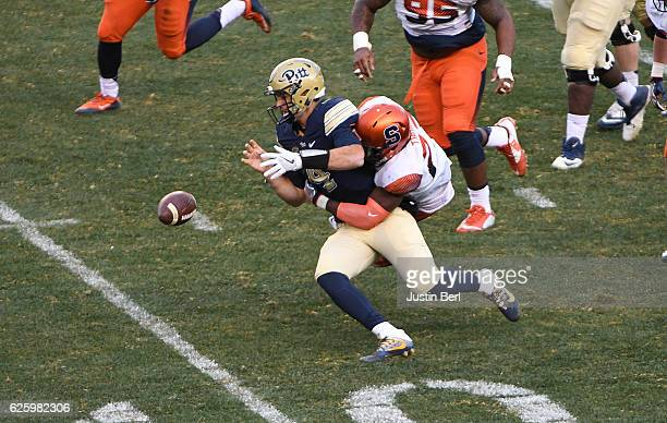 Jonathan Thomas of the Syracuse Orange forces a fumble by Nathan Peterman of the Pittsburgh Panthers in the fourth quarter during the game at Heinz...