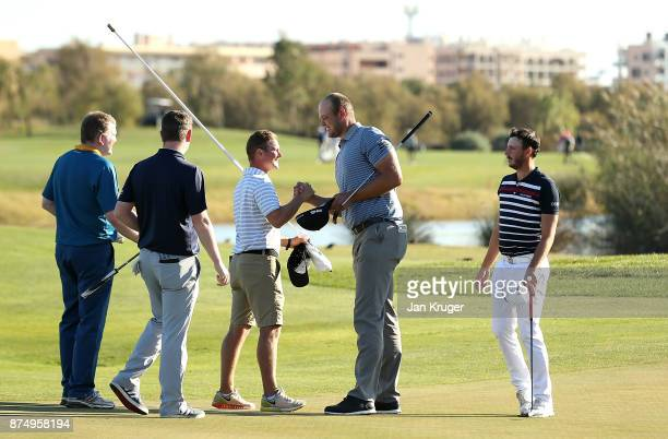 Jonathan Thomson of England celebrates with his caddie after earning his card during the final round of the European Tour Qualifying School Final...