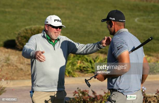 Jonathan Thomson of England is congratulated by his father after earning his card during the final round of the European Tour Qualifying School Final...