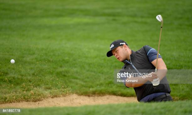 Jonathan Thomson of England plays a bunker shot on the 10th hole during the third round of the DD REAL Czech Masters at Albatross Golf Resort on...