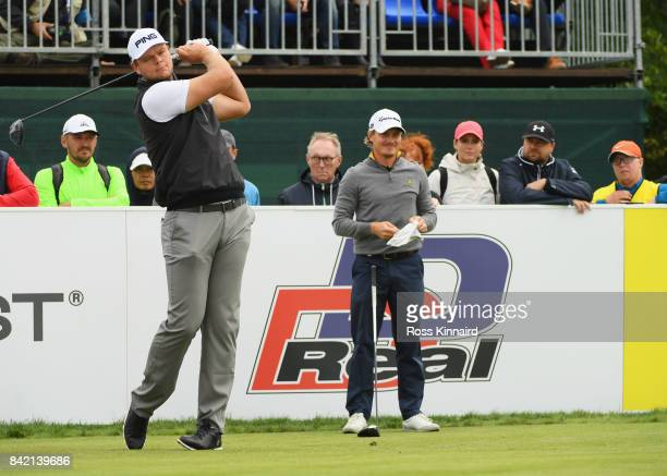 Jonathan Thomson of England tees off on the 1st hole as Pontus Widegren of Sweden looks on during the final round on day four of the DD REAL Czech...