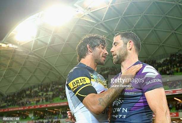 Jonathan Thurston of the Cowboys is congratulated by Cameron Smith of the Storm after the Cowboys won the NRL Second Preliminary Final match between...