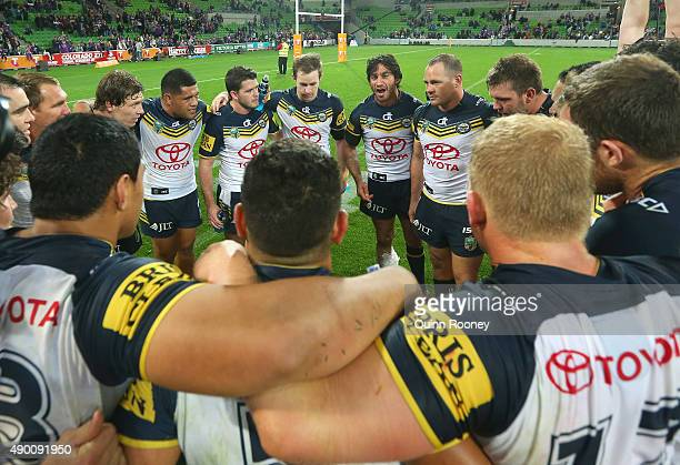 Jonathan Thurston of the Cowboys talks to his team mates after winning the NRL Second Preliminary Final match between the Melbourne Storm and the...