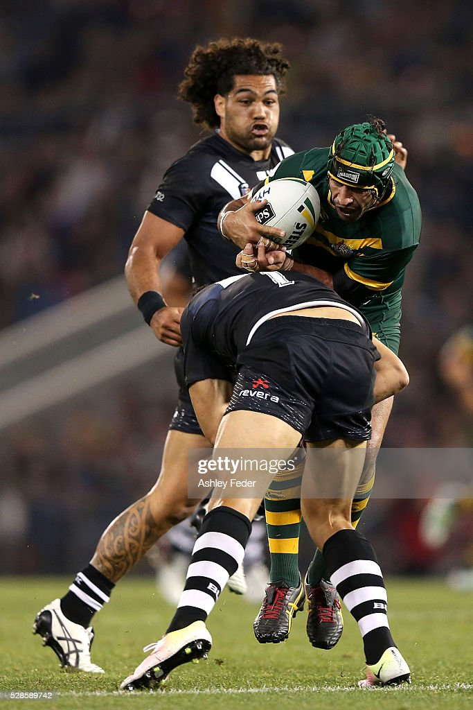 Jonathan Thurston of the Kangaroos is chased by <a gi-track='captionPersonalityLinkClicked' href=/galleries/search?phrase=Adam+Blair&family=editorial&specificpeople=709053 ng-click='$event.stopPropagation()'>Adam Blair</a> of the Kiwis during the International Rugby League Trans Tasman Test match between the Australian Kangaroos and the New Zealand Kiwis at Hunter Stadium on May 6, 2016 in Newcastle, Australia.